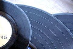 Vinyl records. Close-up of various 33 and 45 RPM vinyl records stock photography