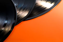 Vinyl records. 3 vinyl - LP records on an orange background with copy space Royalty Free Stock Photos