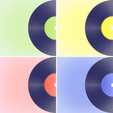 Vinyl records on colored backgrounds Royalty Free Stock Photo