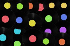 Vinyl records with different colored labels. Stock Photos