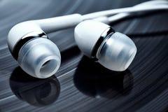 Vinyl records and earphones Royalty Free Stock Photo