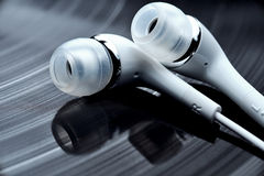 Vinyl records and earphones Royalty Free Stock Photography
