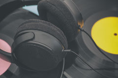 Vinyl records and headphones Stock Photos