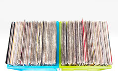 Vinyl records in plastic boxes isolated on white Stock Photo