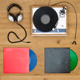 Vinyl records, record player and head phones background Stock Photos