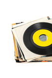Vinyl Records. 45s Vinyl Records stack with old dusty album sleeves on white background. Selective focus Stock Photos