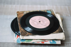 Vinyl records. A stack of old vinyl records on a wooden floor Stock Image