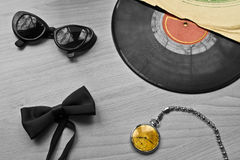 Vinyl records, a tie and the clock Stock Image