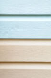 Vinyl siding material for cladding. Patttern of light blue and brown vinyl siding furniture for exterior wall cladding Royalty Free Stock Photo
