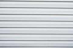 Vinyl siding in very pale gray color Stock Photos