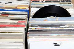 Vinyl 7& x22; single 45 rpm records for sale at a retro record fair.  Stock Photography
