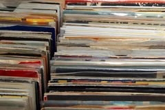 Vinyl 7& x22; single 45 rpm records for sale at a retro record fair.  Stock Images