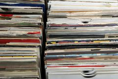 Vinyl 7& x22; single 45 rpm records for sale at a retro record fair.  Stock Photos
