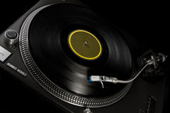 Vinyl turntable on black Stock Images