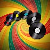 Vinylaufzeichnungen über Mehrfarbenweinlesestrudelhintergrund Stockfotos