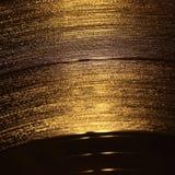 vinyle d'enregistrement d'or de plan rapproché photo libre de droits