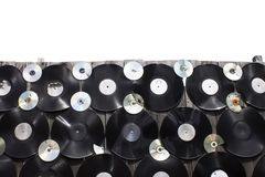 Vinyls and cd are screwed to a fence on white background, isolate stock photos