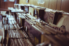 Vinyls stacked in shelves. Huge collection of records stacked along in shelves Stock Photo