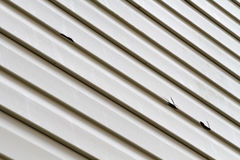 Vinylseitenkonsole beschädigt durch Hagel-Sturm Stockbilder