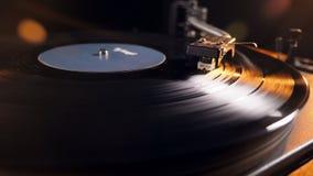 Vinylskivspelare med en roterande diskett lager videofilmer