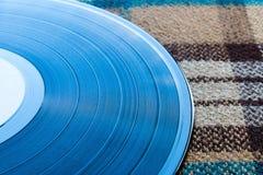 Vinylverslag op een plaid Stock Fotografie