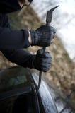Violação criminosa do carro do ladrão Fotografia de Stock Royalty Free