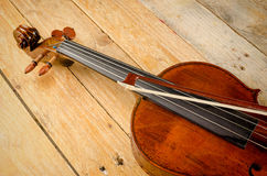 Viola and arch. Old viola and arch on a wooden background Stock Photography