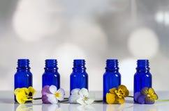 Viola tricolor nice pansies,essential oil in bottle Royalty Free Stock Image
