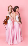 Viola and violin duo. On a pink background Stock Image