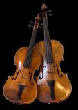 Viola and violin II. Violin and viola isolated on black Stock Photo