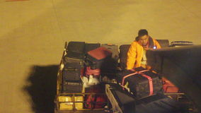Violance Unloading at Nanjing Airport. HD. Nanjing, Jiangsu, China- February 11, 2015: A Ground Staff is Unloading the Cargo From the Airplane, His Movement is stock video footage