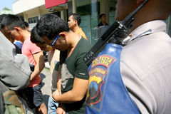 Violate immigration laws. Police arrested Chinese nationals who violate immigration laws in the city of Solo, Central Java, Indonesia Royalty Free Stock Photography