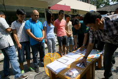 Violate immigration laws. Police arrested Chinese nationals who violate immigration laws in the city of Solo, Central Java, Indonesia Stock Photos