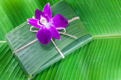 Violate orchid on  banana leaf. Violate orchid on green banana leaf Stock Photos