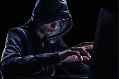 Violation of intellectual property rights concept. Hacker in a hood. Violation of intellectual property rights concept. Hacker in a hood on black background royalty free stock photography