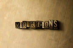 VIOLATIONS - close-up of grungy vintage typeset word on metal backdrop Stock Photography