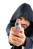 Violence. Man with a weapon pointing at camera Stock Photography