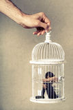 Violence against women. Woman in cage. Deprivation of liberty. stock photos