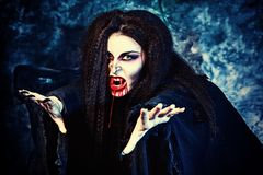 Violence. Bloodthirsty vampire flying at the night cemetery in the mist and moonlight Stock Images