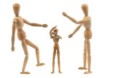 Violence concept with wooden hinged dummies. Violence made on a child with wooden dummies on white background stock photo