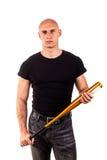 Violence et concept d'agression - main fâchée criarde furieuse d'homme tenant la batte de sport de base-ball Images stock