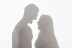 Violence of man against woman. Silhouette of men and women standing on white background and quarrelling Royalty Free Stock Images