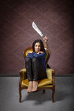 Violence on woman metaphor with knife Royalty Free Stock Image