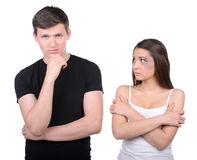 Violence Woman. Scared women staying near thoughtful sad man. Idea of uncontrolled rude behavior Stock Photos