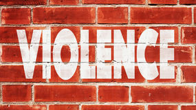 Violence Written On A Brick Wall. Violence On A Brick Wall Stock Photos