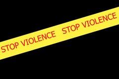 VIOLENCIA de la PARADA del lema en la cinta amarilla imagen de archivo