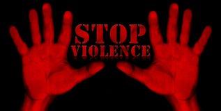 Violencia de la parada - manos rojas Imagen de archivo libre de regalías