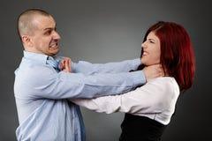 Violent argument between colleagues. White collar workers having a violent quarrel Stock Photography