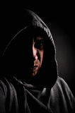 Violent gang member. Low key portrait of a violent gang member Stock Images