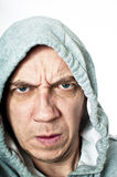 Violent hooded thug. Concept portrait of a violent hooded male isolated against white Royalty Free Stock Photography